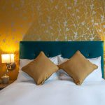 Gold-and-silver-wallpaper-in-Coach-House-Inn-bedroom